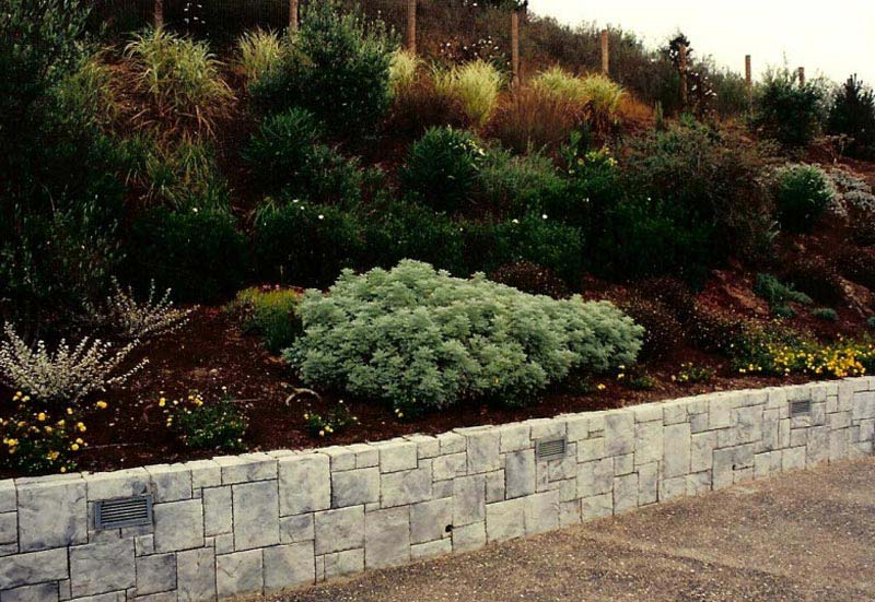 Hillside landscaping with rocks landscape design for Hillside rock garden designs