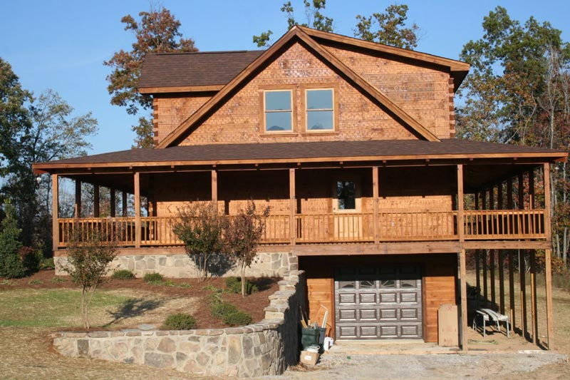 Rustic cabin plans for enjoying your weekends away from for Full wrap around porch log homes
